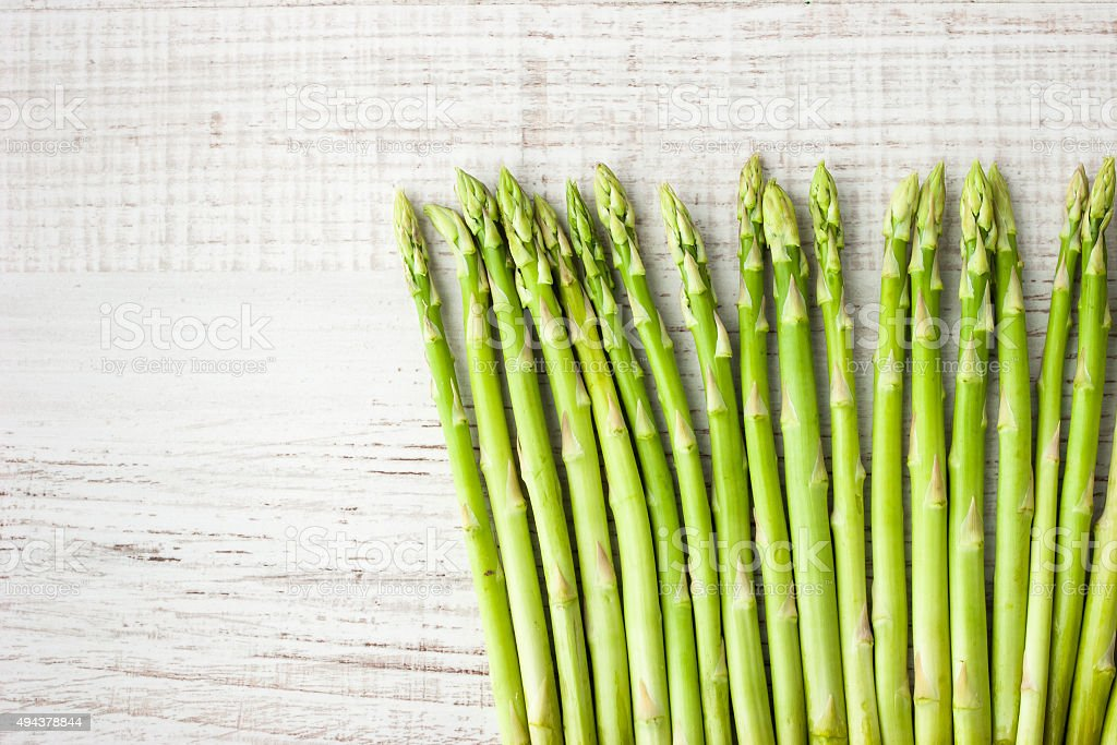 Sprigs of asparagus  on the white  table stock photo
