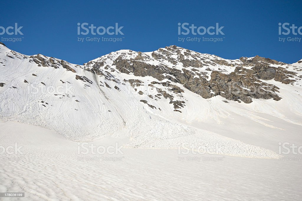 Spring avalanches in the Alps royalty-free stock photo