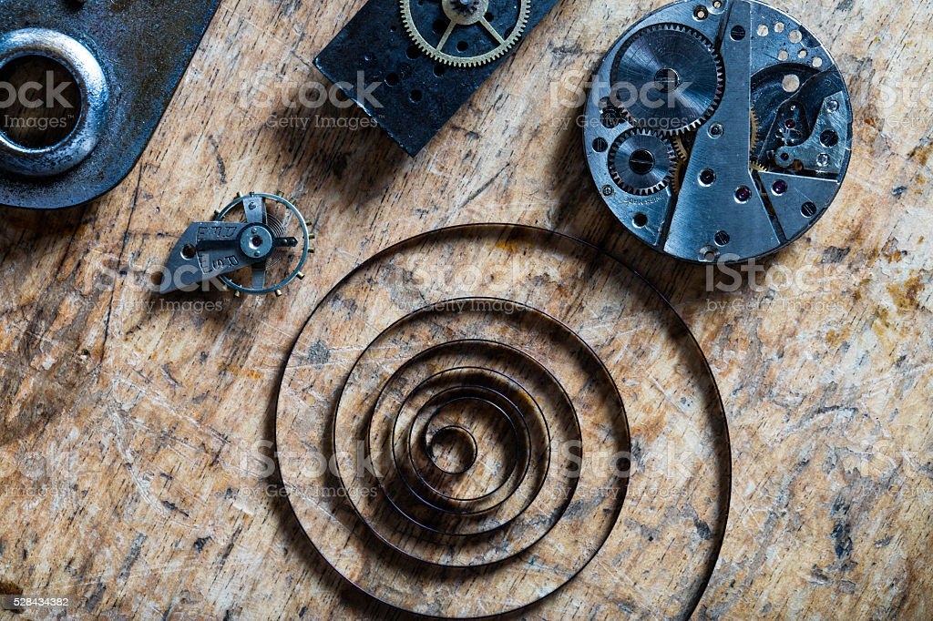 spring, balance wheel and clockworks on a table stock photo