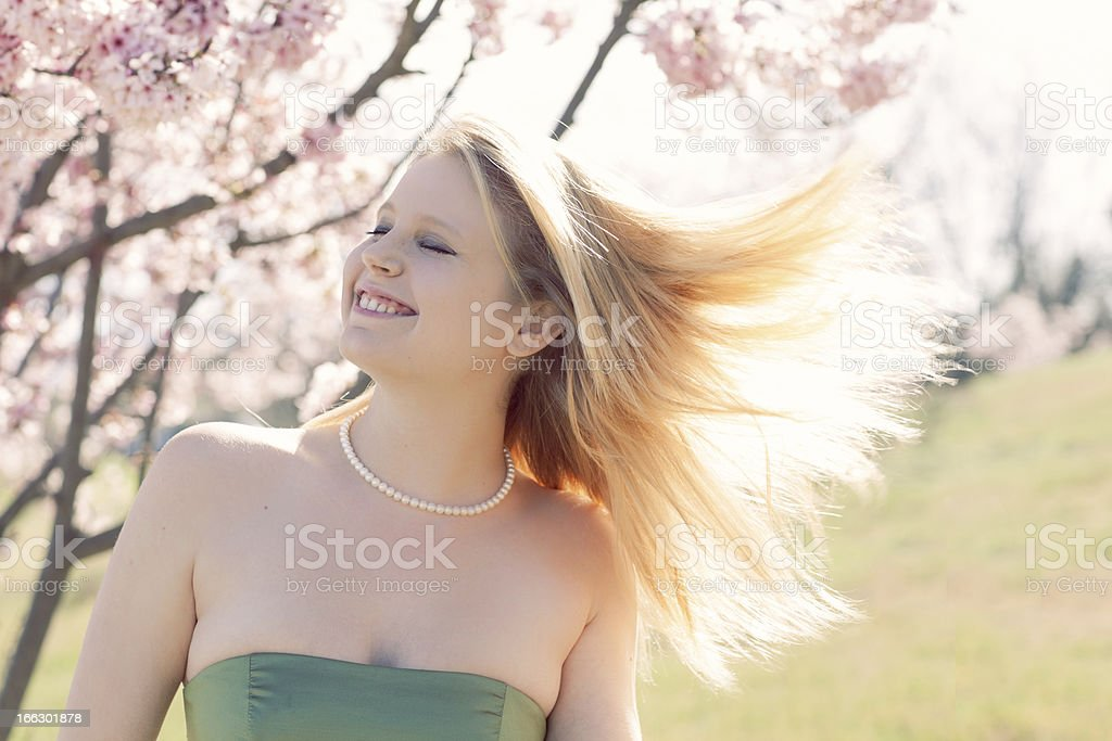 Spring Beauty woman in cherry blossoms stock photo