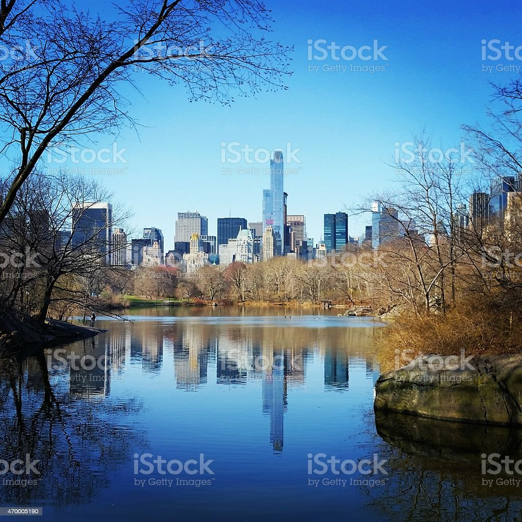 NYC Spring Blue Morning Central Park Cityscape View Water Reflection stock photo