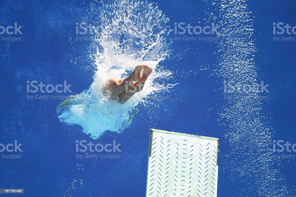 Spring board diving stock photo