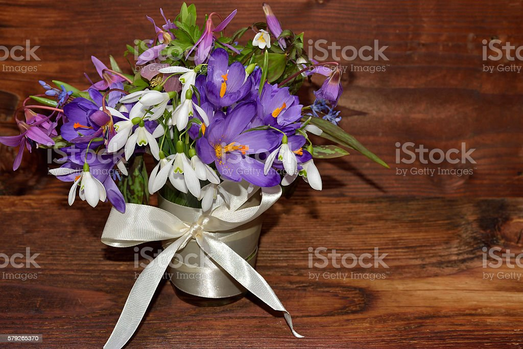 Spring bouquet of flowers on wood stock photo