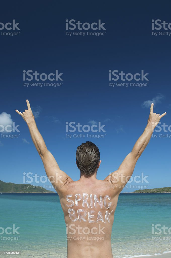 Spring Break Dude Rocking Out Caribbean Beach royalty-free stock photo
