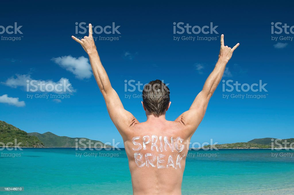 Spring Break Dude Throws His Arms in the Air royalty-free stock photo