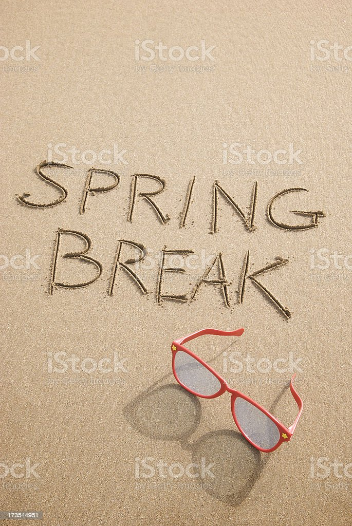 Spring Break with Sunglasses in the Sand royalty-free stock photo