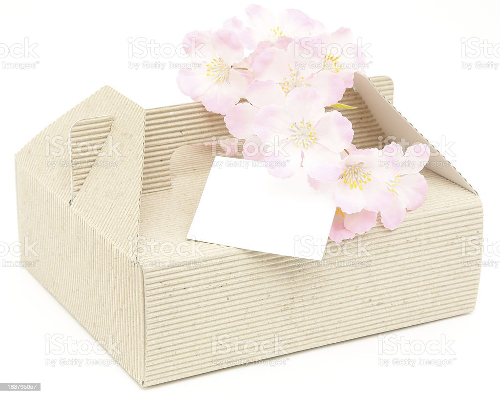 Spring cake box  with blank message card isolated royalty-free stock photo