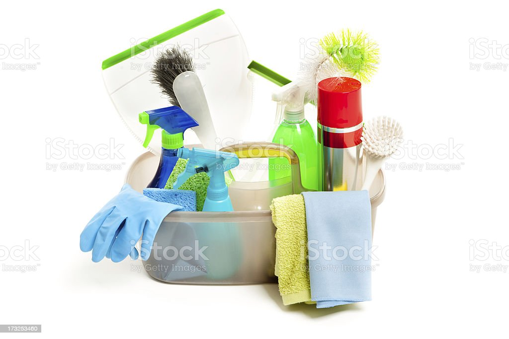 Spring Cleaning Equipment and Cleanser in Caddy on White Background stock photo