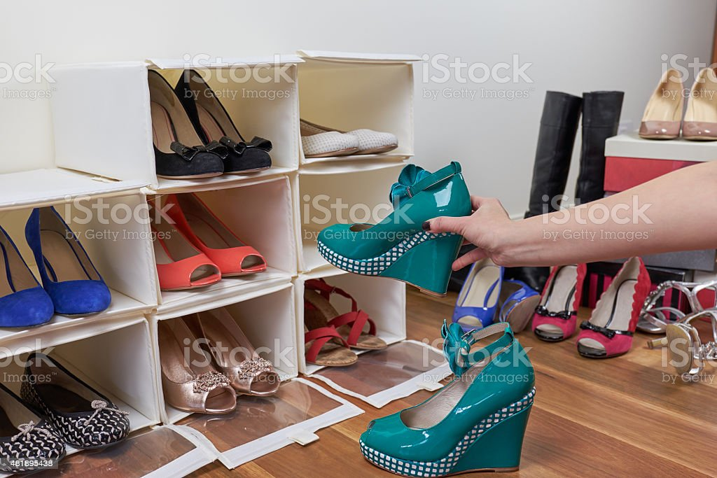 spring cleaning organising shoes stock photo