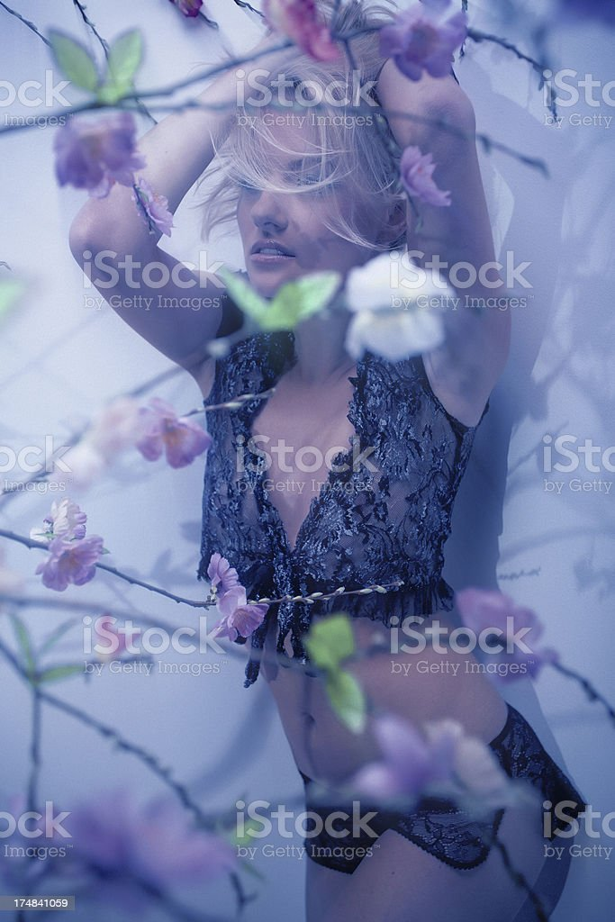 spring female portrait on the peach-blossom royalty-free stock photo