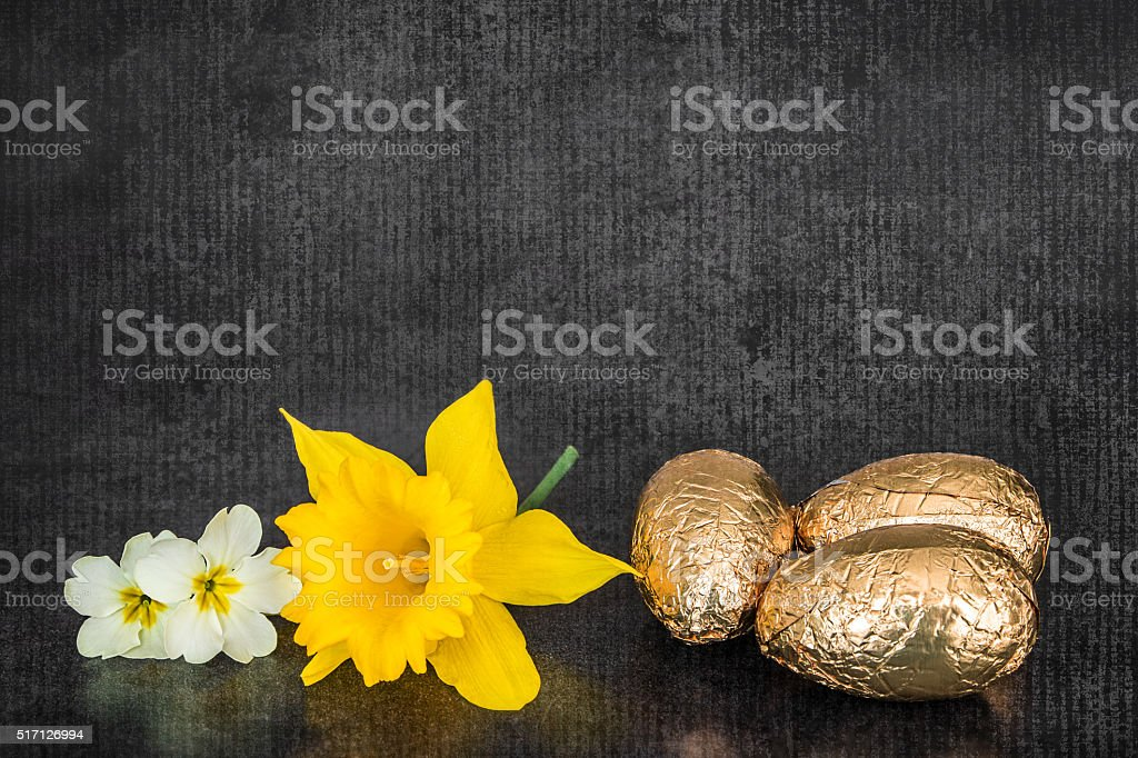 Spring flowers and easter chocolat eggs double exposure texture stock photo