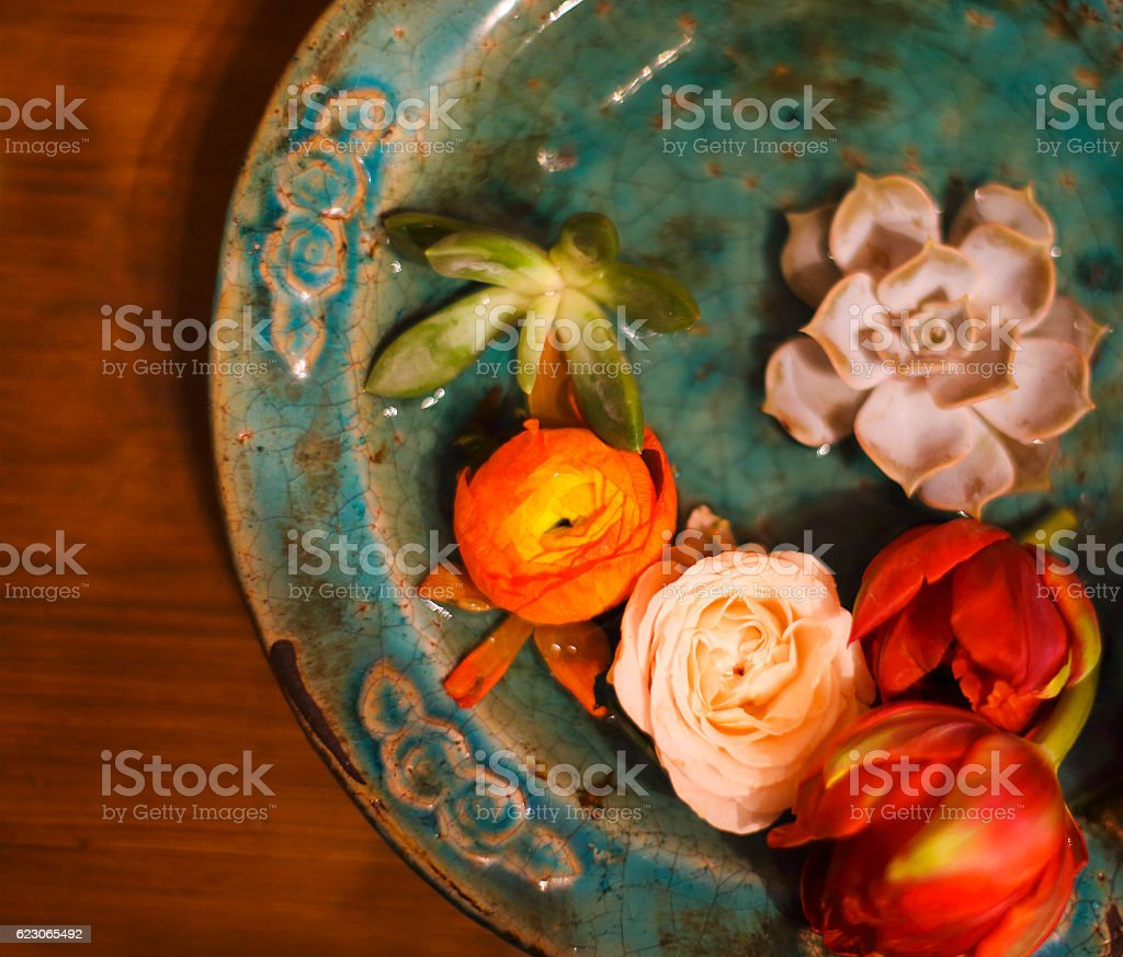 Spring flowers for spa on wooden table stock photo