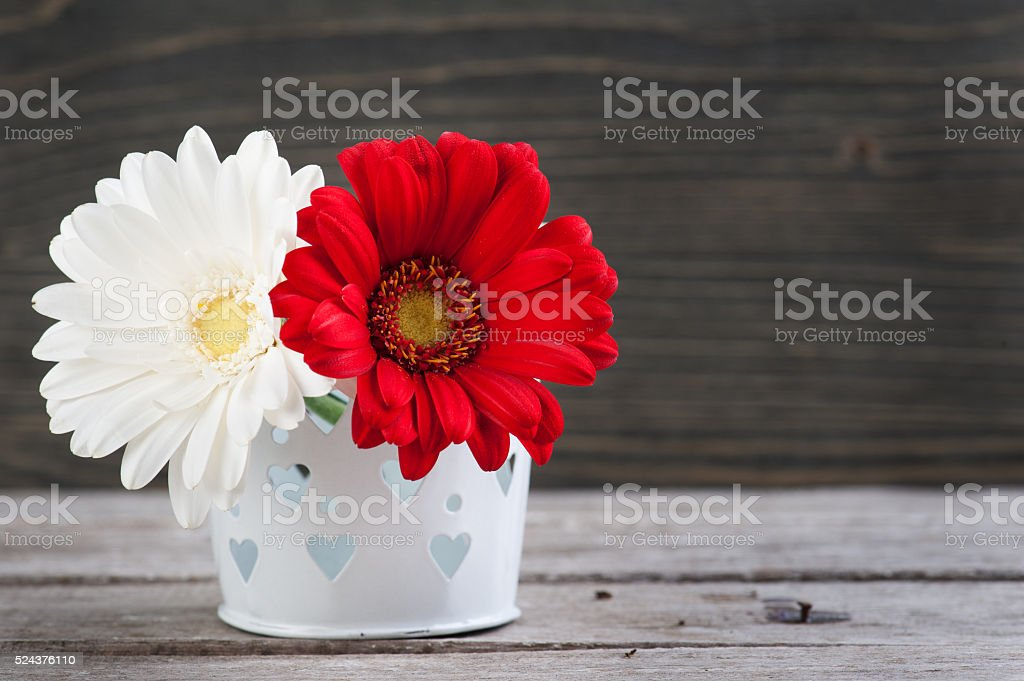 Spring flowers in vase on wooden table stock photo