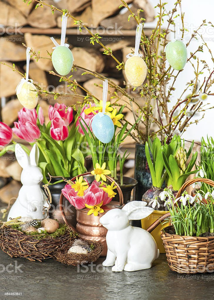spring flowers with easter bunny and eggs decoration stock photo