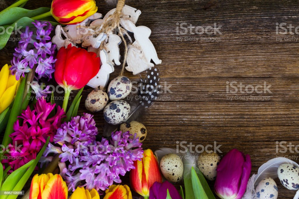 Spring flowers with easter eggs stock photo