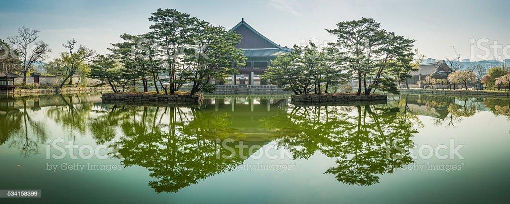 Spring foliage temple pagoda reflecting in tranquil pool Seoul Korea stock photo