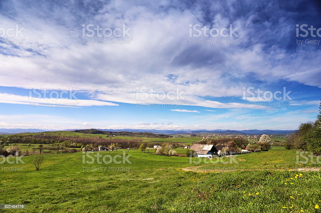 Spring green hills blooming. Valley behind the foothills stock photo