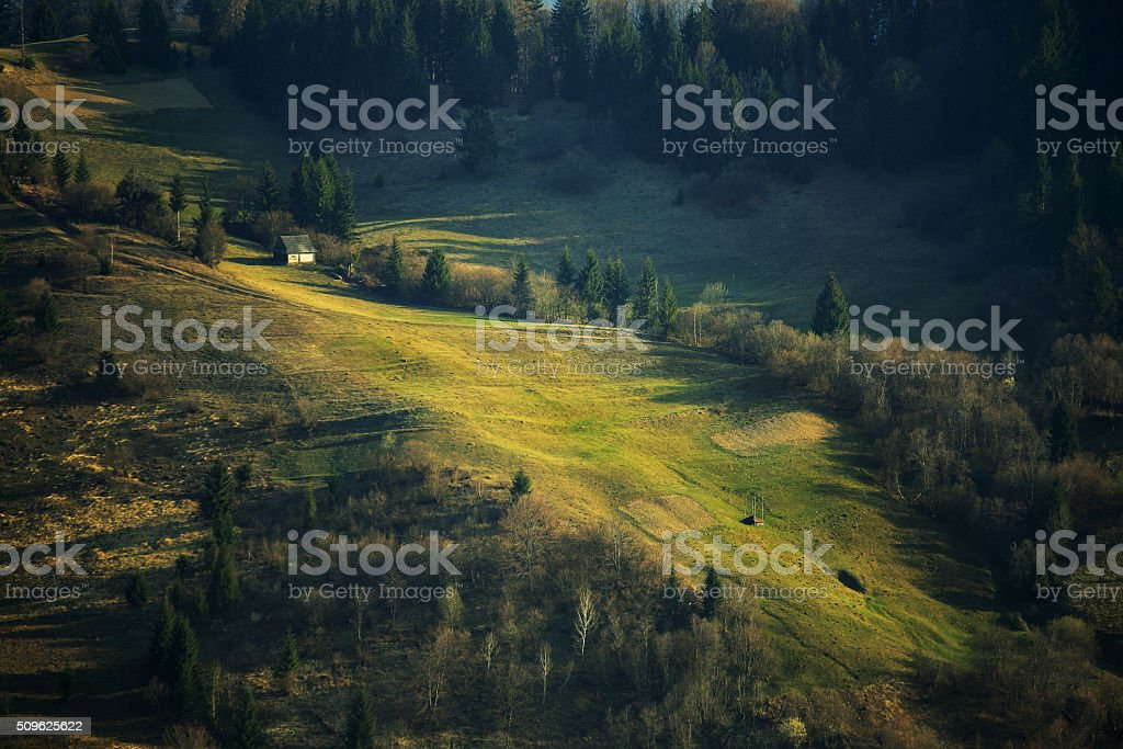 Spring green hillsides. Sunny April in mountains. stock photo