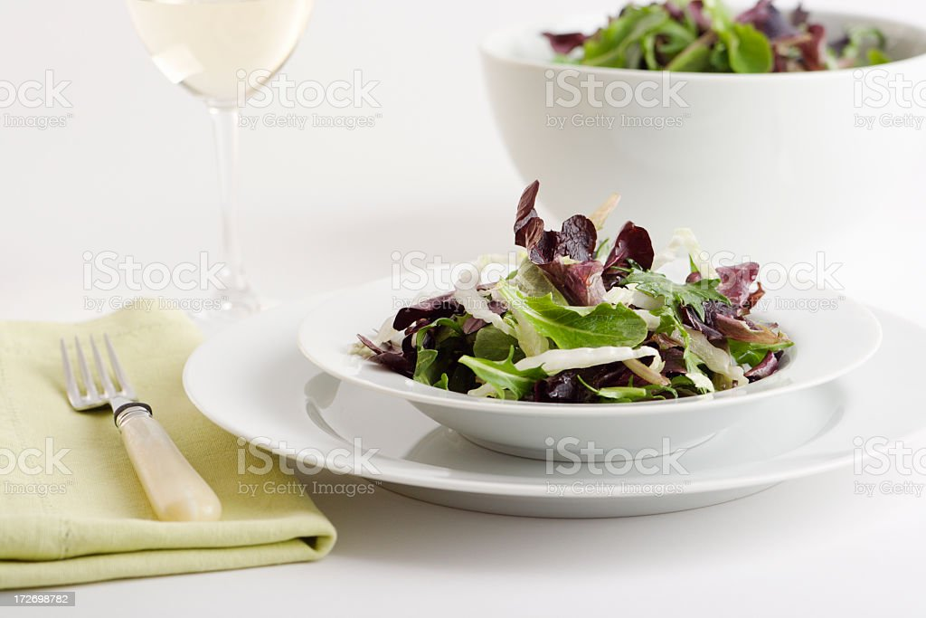 Spring Greens Salad Course in White Bowl, Plate Place Setting royalty-free stock photo
