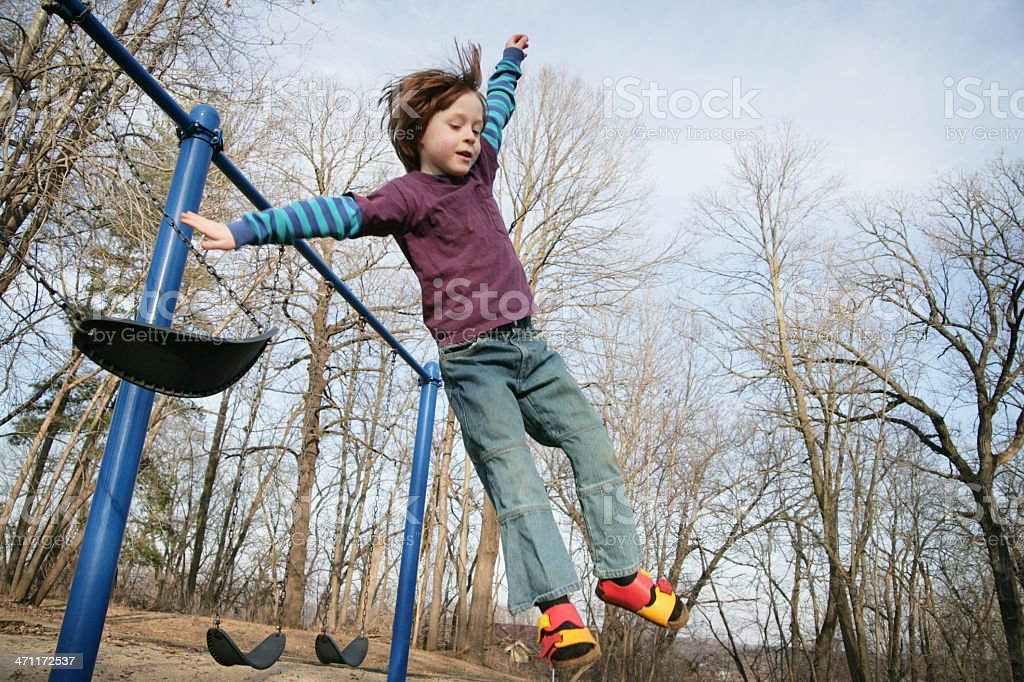 Spring Has Sprung!- Cute Little Boy Jumps From a Swing stock photo
