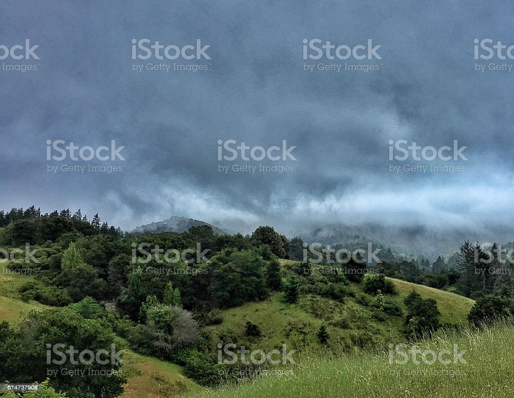 Spring hills and storm clouds stock photo