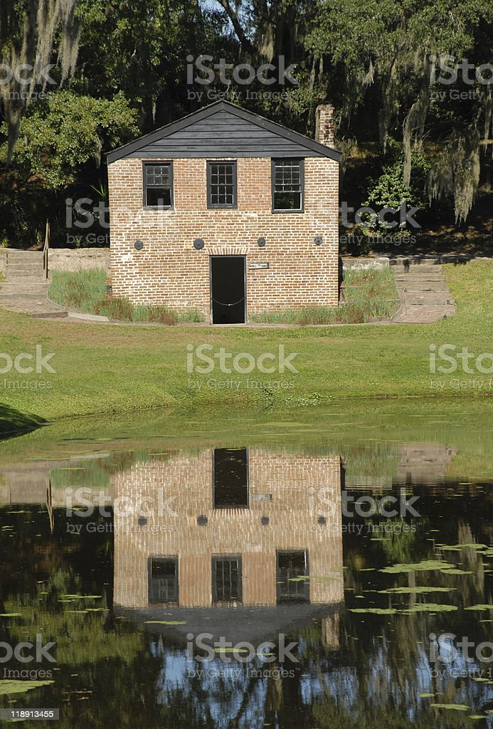 Spring House reflected in pond at Middleton Place stock photo