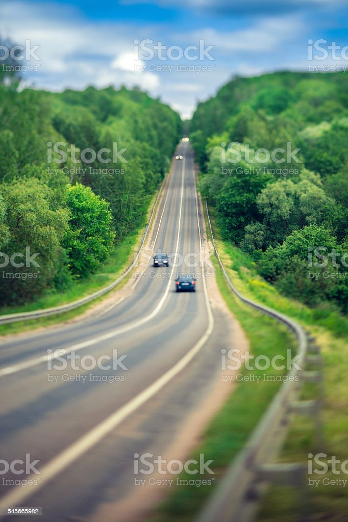 spring landscape and the road (tilt shif) stock photo