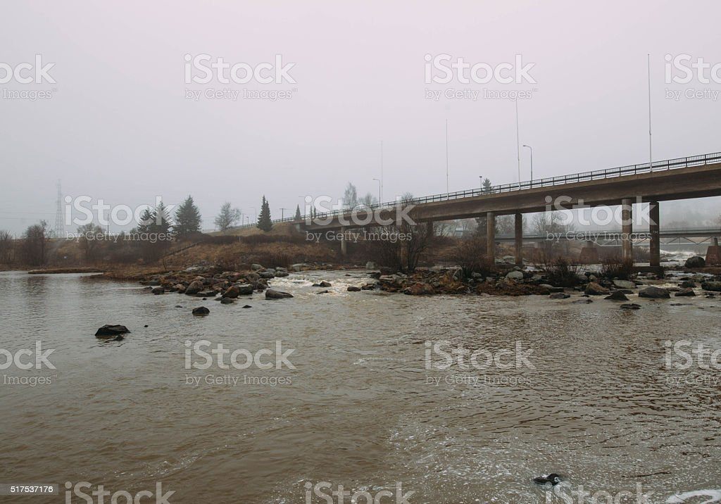 spring landscape with fog of the old bridge stock photo