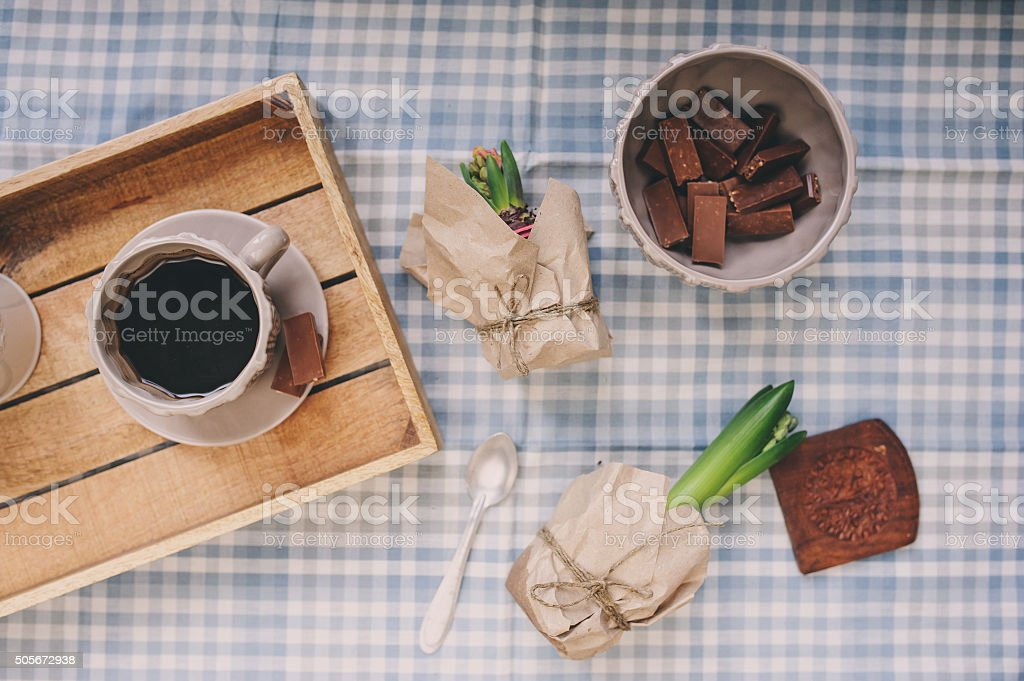 spring morning at home, table with coffee and hyacinth flowers stock photo