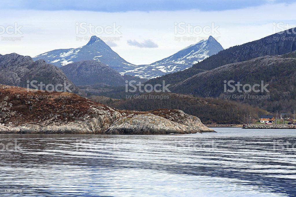 Spring Norwegian landscape with sea and mountains royalty-free stock photo