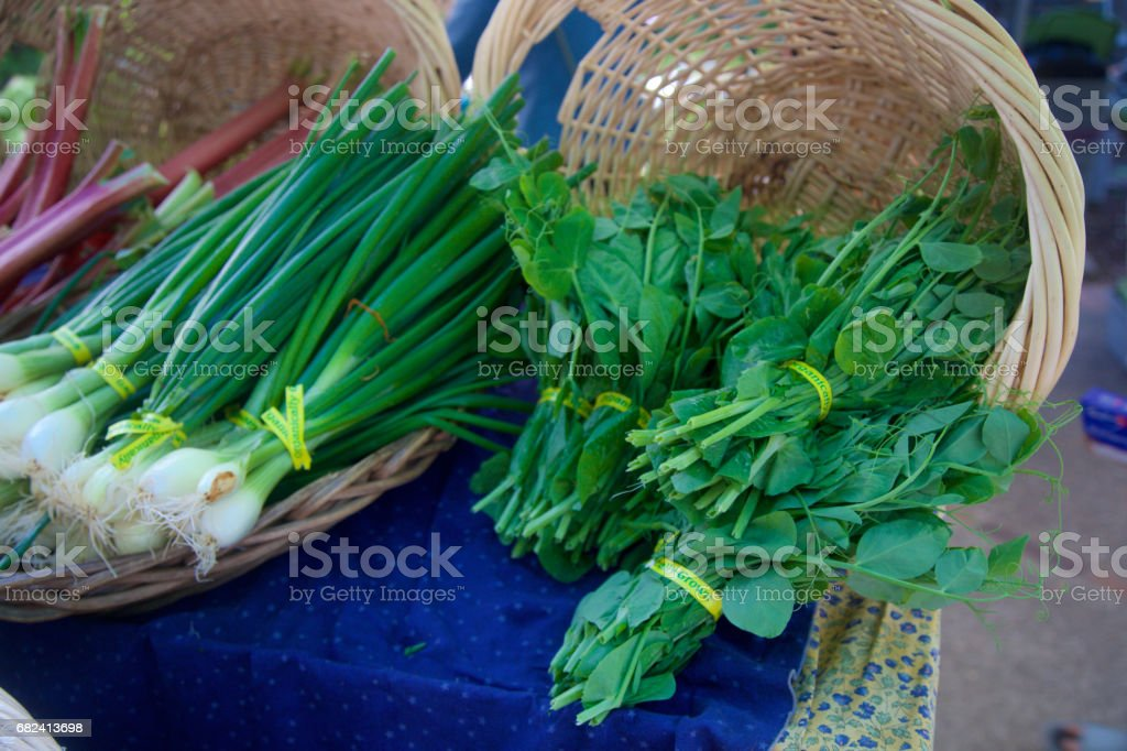 spring onion bunches and pea shoots stock photo