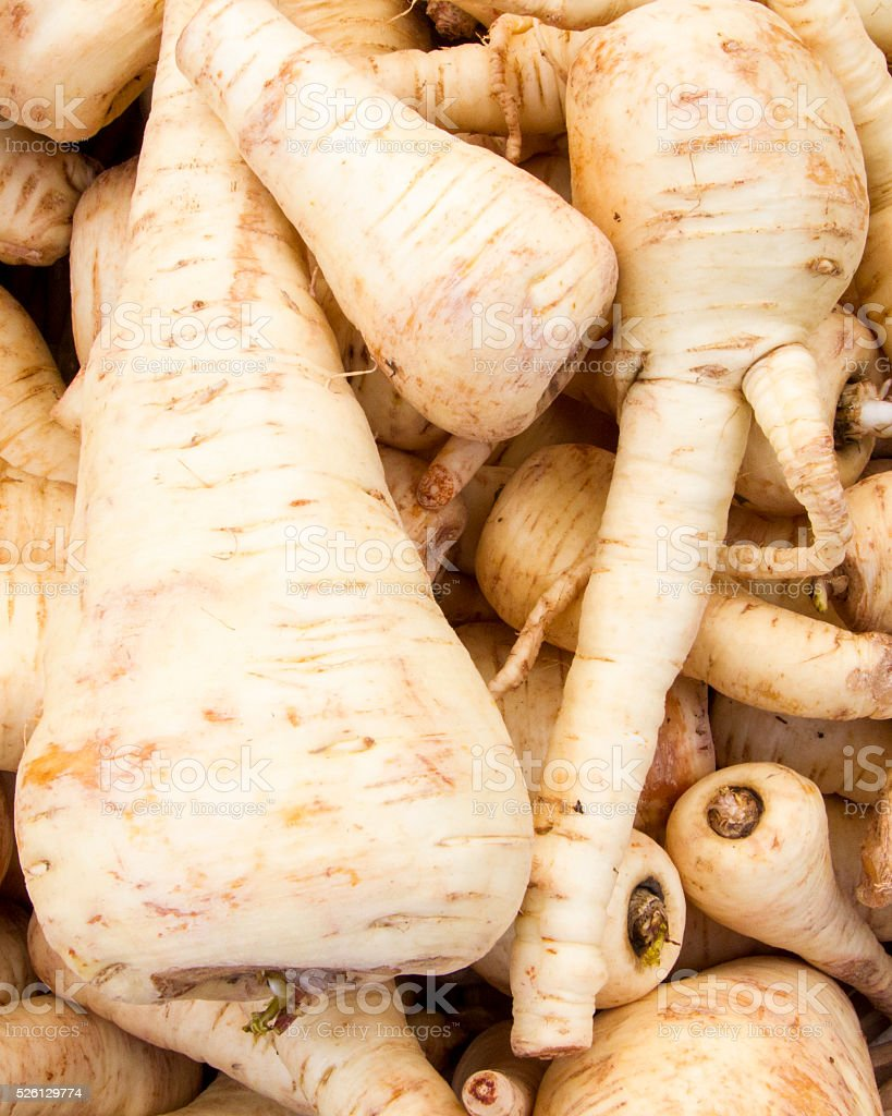 Spring parsnips for sale at a farmer's market stock photo