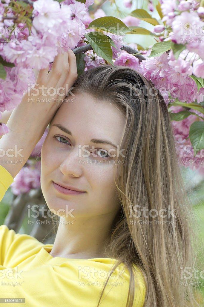 Spring portrait beautiful woman with sakura tree royalty-free stock photo