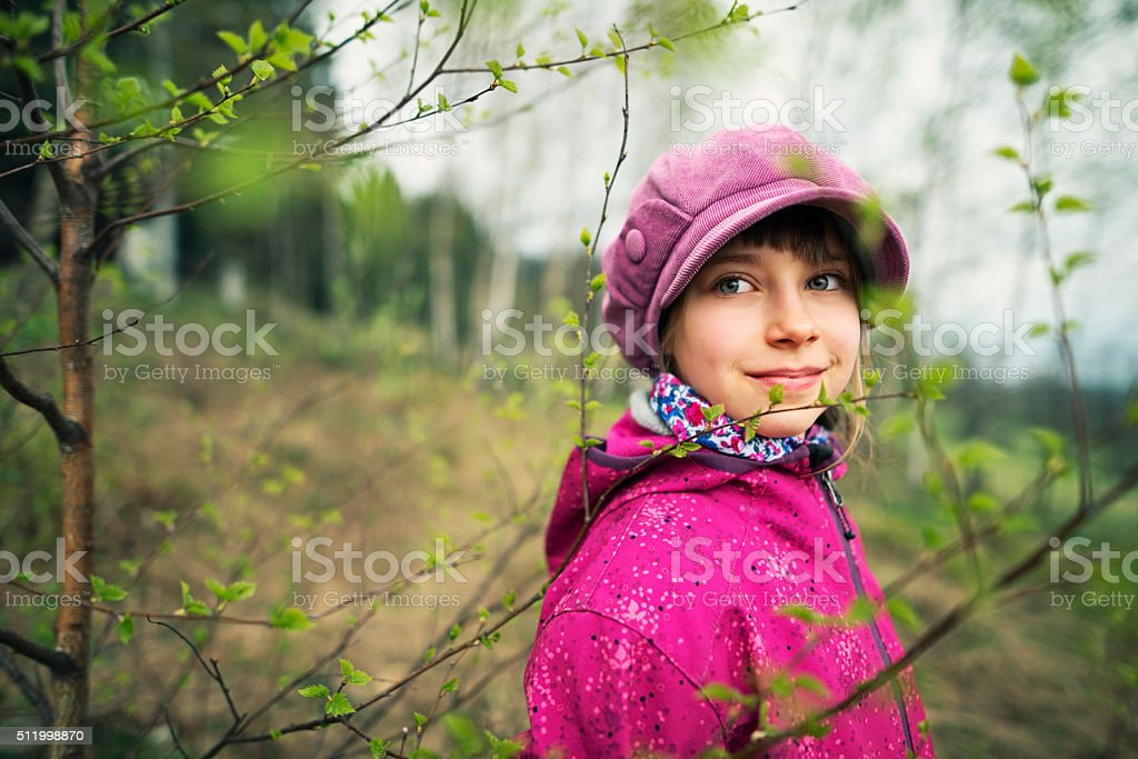 Spring portrait of a little hiker girl stock photo