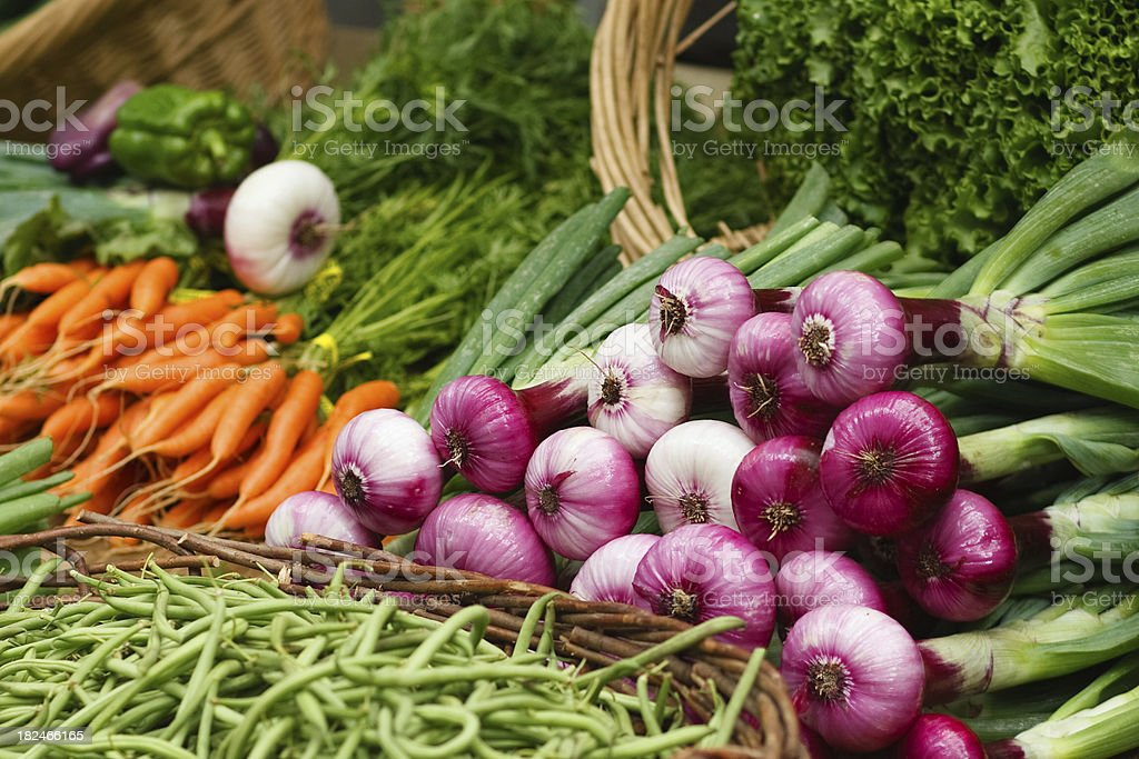 spring red onions at a farmers market. stock photo