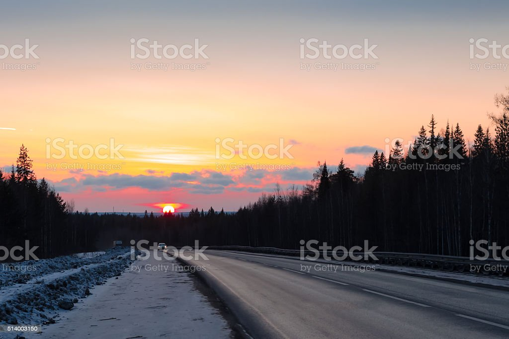 Spring road with cars at sunset stock photo