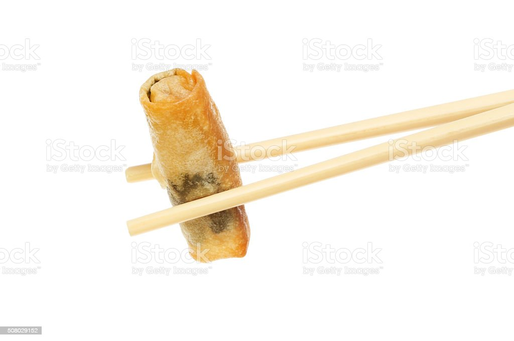 Spring roll in chopsticks stock photo