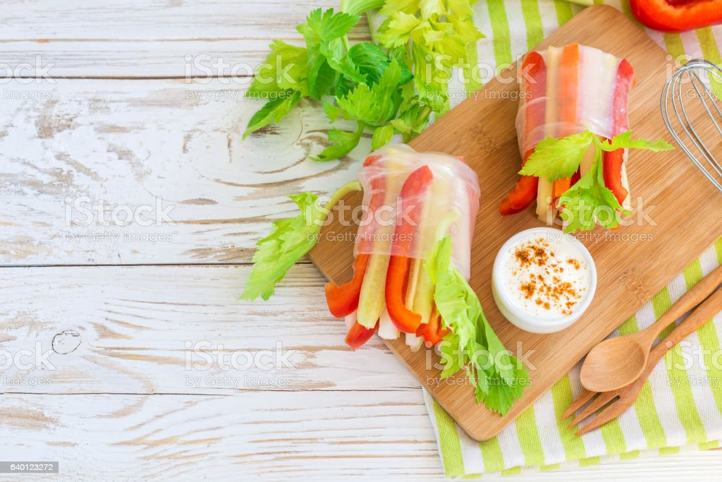 Spring roll with vegetables and white sour cream souce stock photo