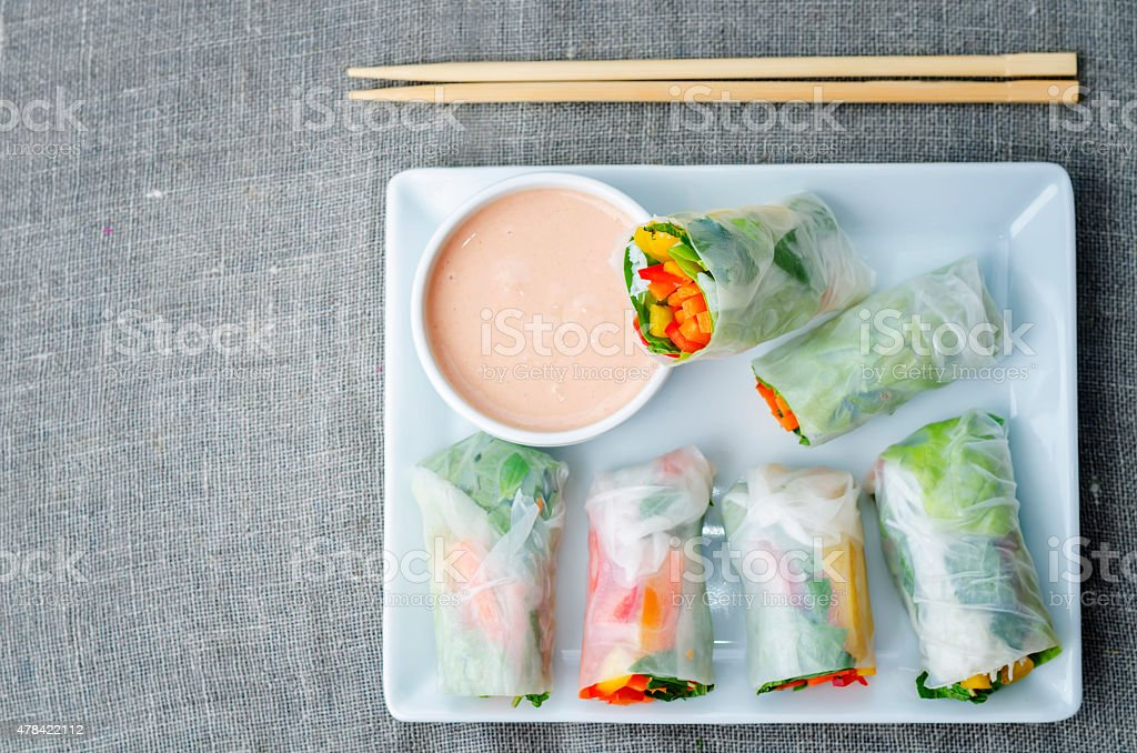 spring rolls with chili mayonnaise dressing stock photo