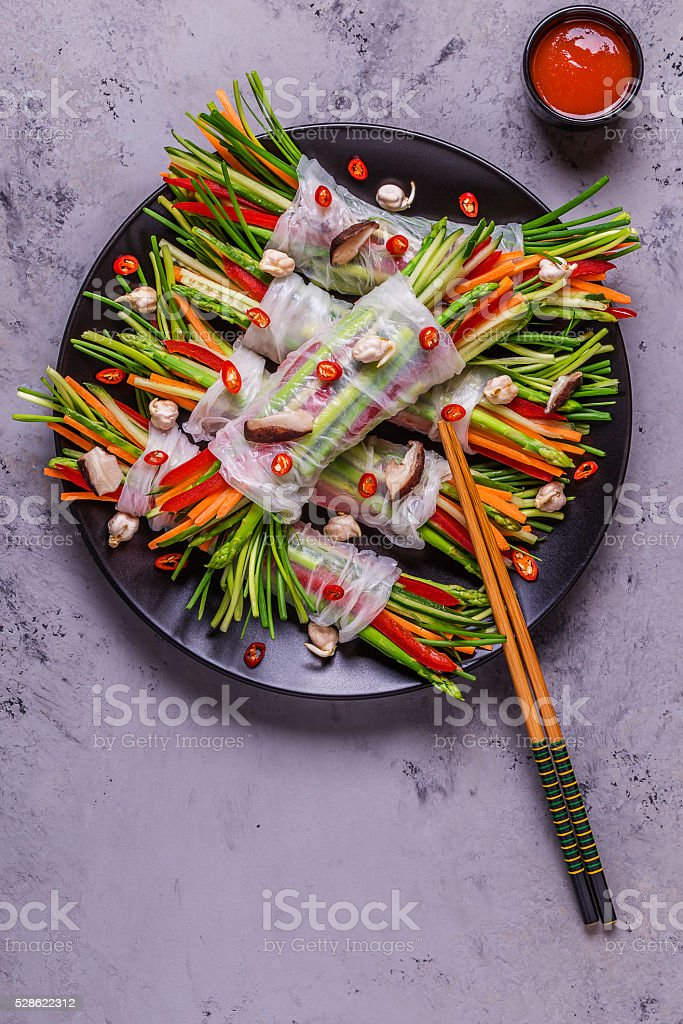 Spring rolls with vegetables and shiitake mushrooms on a plate. stock photo