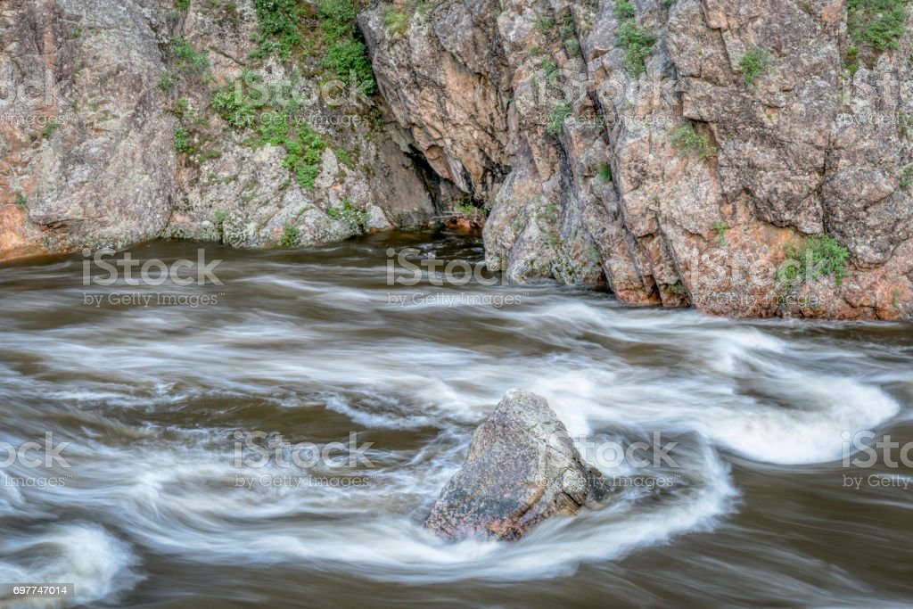spring runoff of Poudre River in Colorado stock photo