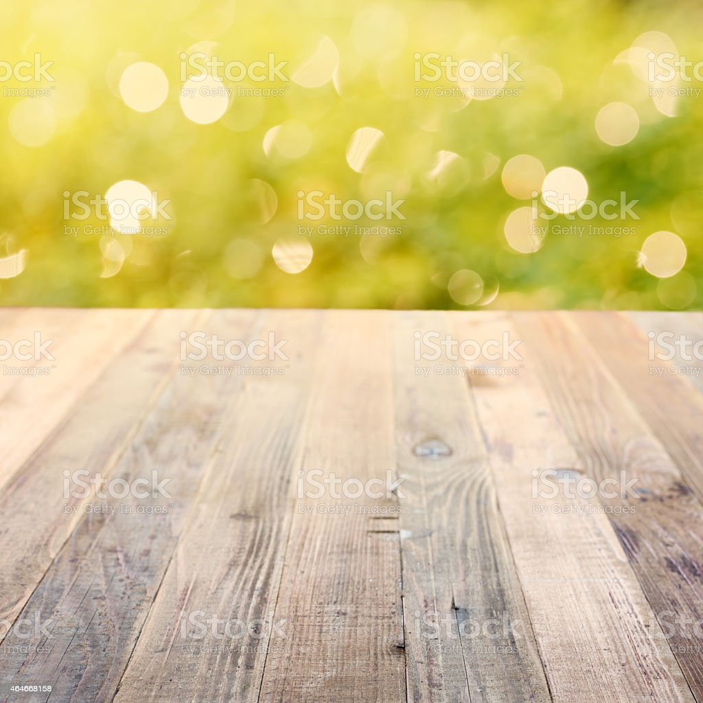 Spring rustic background with green bokeh stock photo