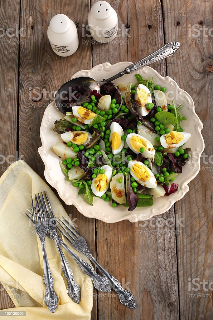 Spring salad with green pea, potato and eggs royalty-free stock photo