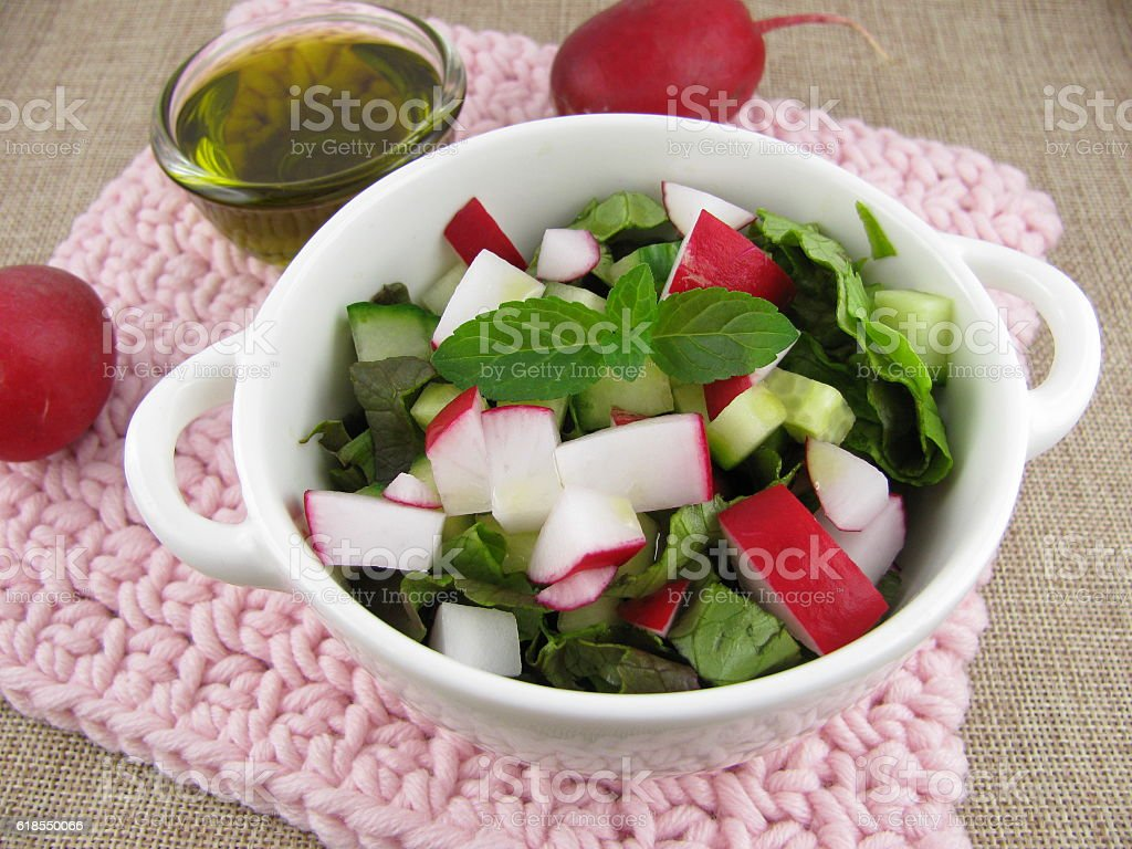 Spring salad with hemp oil stock photo