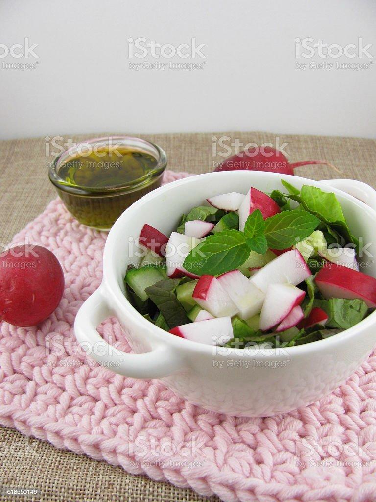 Spring salad with hemp oil stock photo