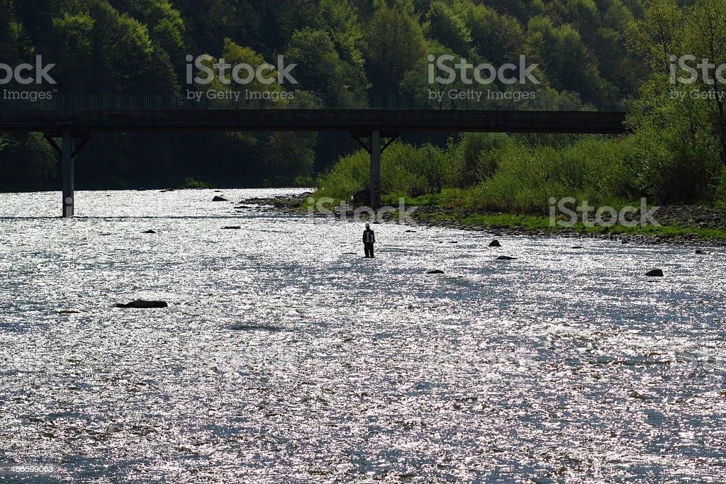 Spring. Silhouette of Fisherman. stock photo
