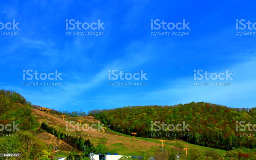 Spring skiing without snow stock photo