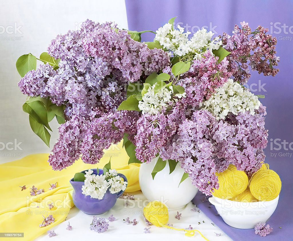 Spring still life with flowers bunch and wool hank stock photo