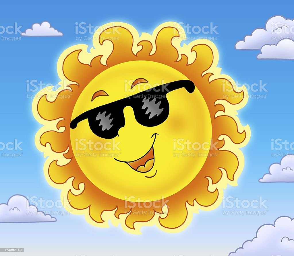 Spring Sun with sunglasses on sky royalty-free stock photo