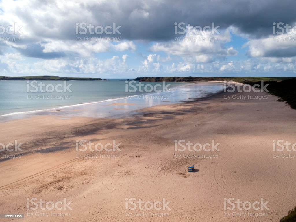 Spring sunshine and showers on South Beach, Tenby, Pembrokeshire, UK stock photo